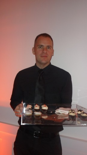 Waiter with Tray of Cupcakes