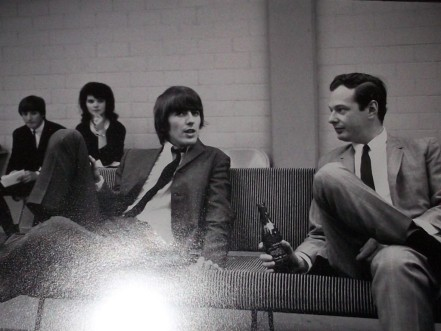 George Harrison and Brian Epstein on Sofa