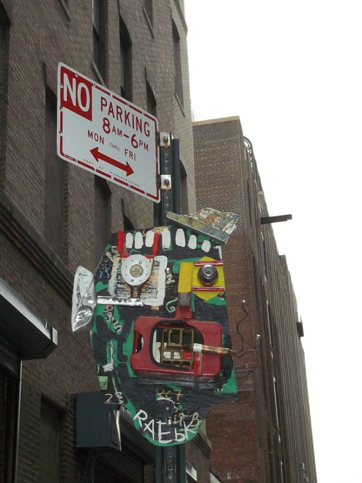 Face Sculpture on No Parking Sign By Rae
