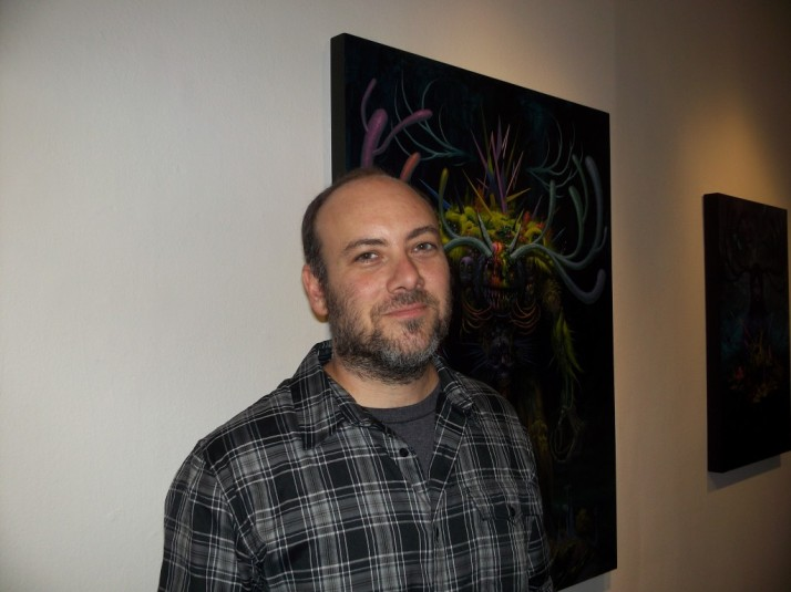 Jeff Soto Poses with his Work