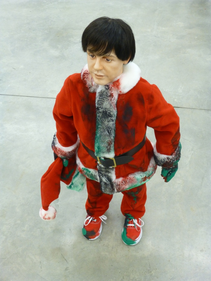 Miniature Paul McCartney in a Santa Suit