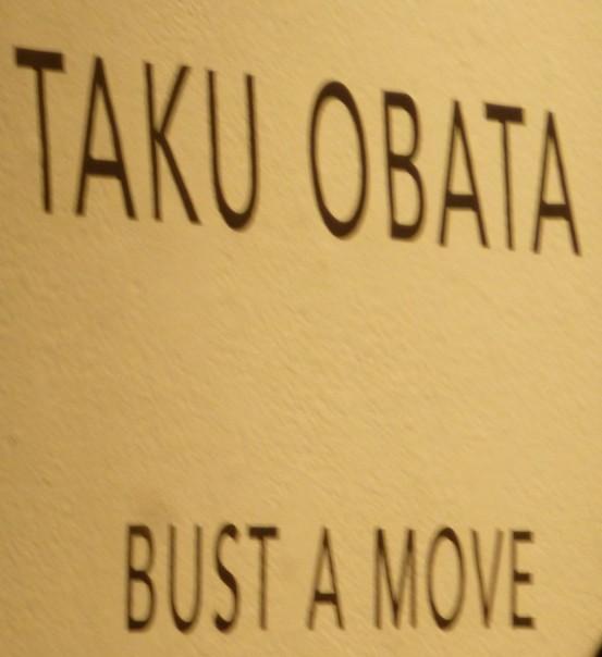 Taku Obata Bust a Move Signage