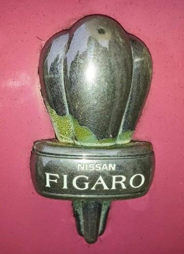 Pink Nissan Figaro Hood Ornament