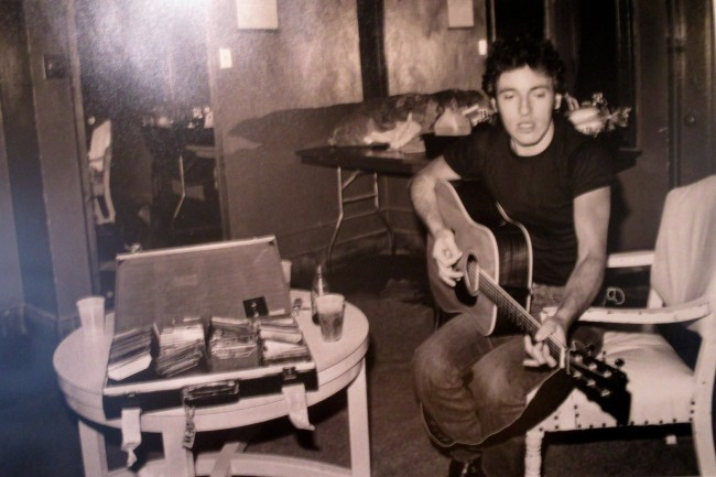 Sitting Bruce with Guitar