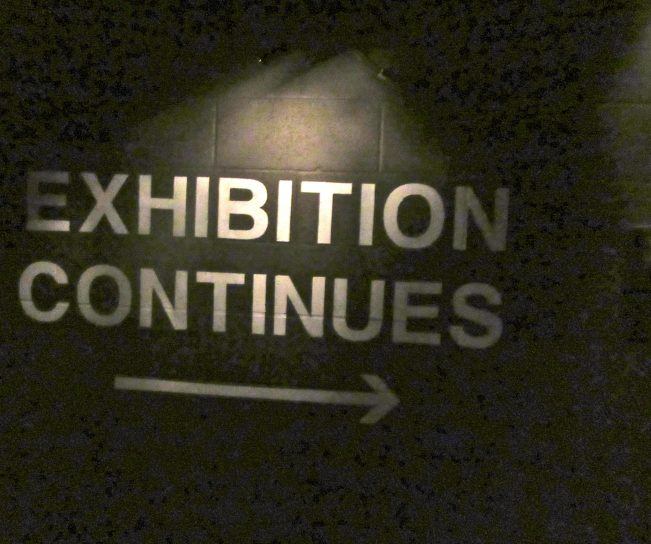 Exhibition Continues Sign