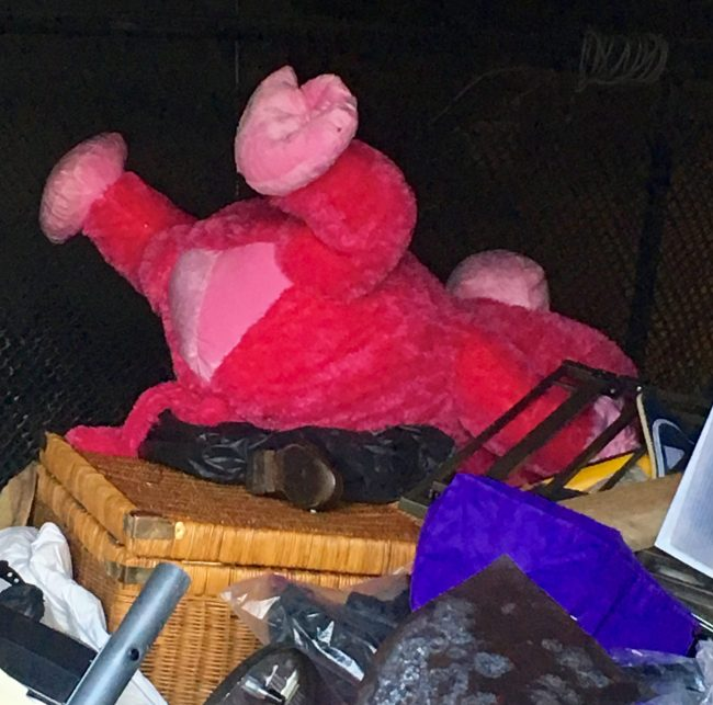 Giant Pink Monkey Plush Toy on a Garbage Heap